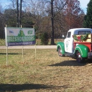 Truck with Trees for Troups sign
